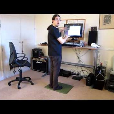 Jake Birkett demonstrating a Conset motorised standing desk